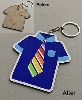 'Before' picture: A wooden key chain cut and printed into a short-sleeve shirt with a neck tie. 'After' picture: The shirt is painted in ultramarine blue with light blue coloured breast pocket & collar. The cuffs of the short sleeves are also painted with light blue. The tie is painted in stripes with black & rainbow colours.