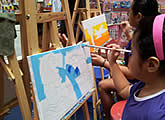 Canvas painting booth at family art event