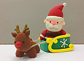Christmas art and craft class or gift idea: clay modelling of a Santa Claus, his sleigh and a reindeer.