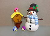 Christmas art and craft class or gift idea: clay modelling of a snowman, a clay bird house and some clay bird friends.