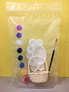 Art supplies / kids birthday party ideas / gift ideas: a package containing a mini cane basket, 8 mini buckets of paint, a paint brush and a palette