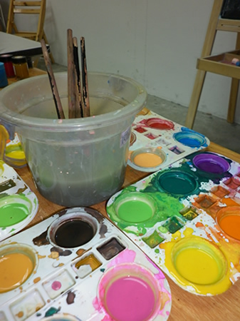 Paint and brushes used by art teacher for teaching in our children art class